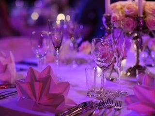 Guest Table at wedding with purple glow lighting