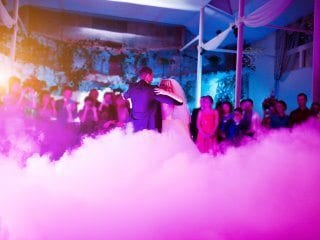 Bride and groom first dance with fog and lighting.  pink and blue