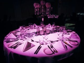 Wedding reception guest table pin spot in light pink.