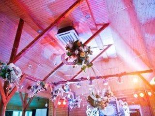 Barn wedding reception uplighting