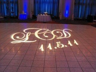 Wedding gobo projection on dance floor with blue uplighting
