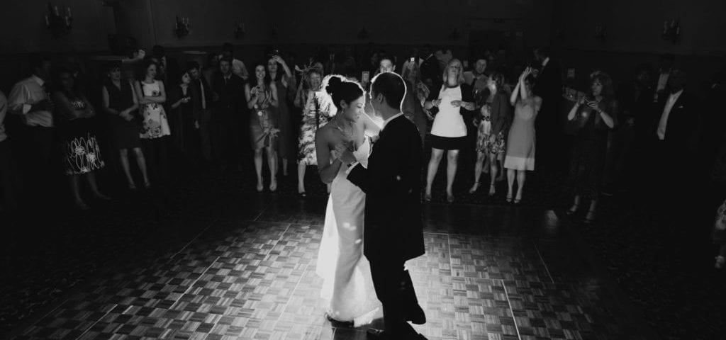 Happy bride & groom first dance in spot light